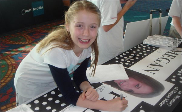A Tweenangel from the Danville Chapter Signing a Megan Pledge Banner